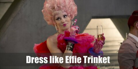 Effie Trinket costume is her pink blazer, pink pencil skirt, and black ankle boot heels.