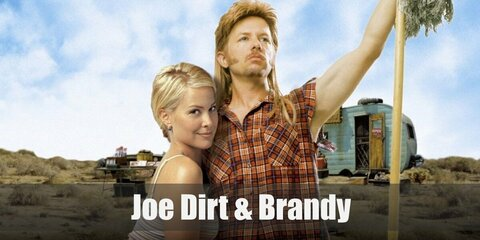 Joe Dirt wears an orange plaid shirt with the sleeves ripped off and acid wash jeans. But the most iconic of his looks is his awesome blonde mullet and peculiar side burns.