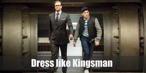 For Kingsman costume, Eggsy's wearing his trademark orange suit with black lapels, black-rimmed glasses, and black Oxfords.