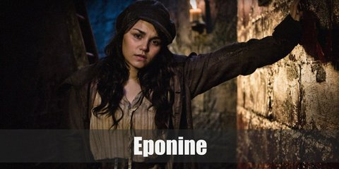 Eponine is known for her white tank top, high waist pants, and huge trench coat outfit.