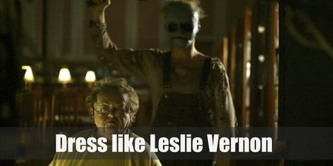 Leslie Vernon costume is a dirty sweater full of holes, a dark blue overall, and a unique mask. He also has a scythe for a weapon.