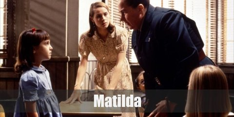 Matilda costume is an adorable denim dress, a white cardigan, cuff socks, black Mary Janes, and red headband.