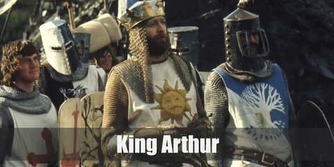 King Arthur's costume is chainmail tunic and cowl, colonial pants, knee-high boots, brown baldric, medieval sword and gauntlets with a crown.