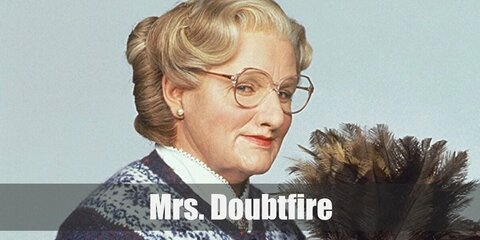 Mrs Doubtfire wears a pink cardigan over her tartan skirt. She also wears a pair of brown brogue shoes. Get a white wig and a pair of eye glasses, too. Complete the costume by carrying a broom.