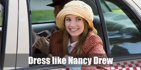 Nancy Drew costume is a yellow turtleneck knit sweater, a plaid skirt, a pair of brown Oxfords, a thick yellow belt, and a yellow headband. She also has a gold magnifying glass.