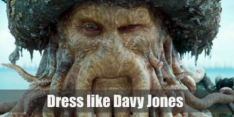Davy Jones wears a worn-out pirate garb consisting of a pirate shirt, a waist or tail coat, goth pants, thick belt, a pirate hat, and boots. To replicate his look, wear an octupus beanie, lobster claws, as well as optional sea shells to glue on the pieces as an added deep-see texture.