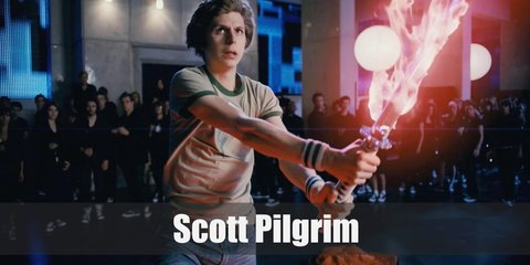 Scott Pilgrim costume involves a yellow tee and denim pants. He wears red sneakers and striped arm bands. He carries a red electric guitar, too.