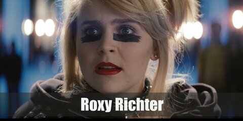 Roxy Richter's costume is a black top, black skirt, a cropped black jacket, black floral tights, and black Uggs. Roxy Richter is one of Ramona's Evil Exes.