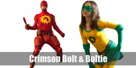 Crimson Bolt and Boltie's costumes are Crimson a red long-sleeved shirt and red pants with red protective gear scattered all around as well as a yellow leotard with a green skirt atop, green gloves, and a green mask.