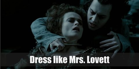 Mrs. Lovett costume is a long gothic dress full of lace and ribbons. Her hair is also in disarray.
