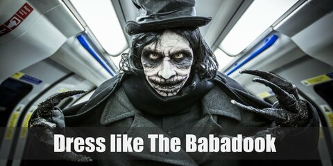 The Babadook wears an all-black ensemble. He has on a black trench coat, black pants, black top hat, and black shoes. Plus, he sports long black hair and equally long black fingers.