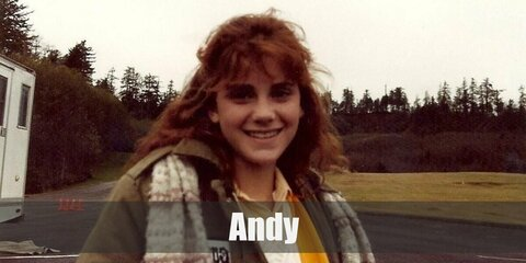 Andy's costume is a yellow collared shirt, a white mini skirt, white shoes and socks, and a yellow letterman cardigan.  Aim to be a pretty and kind cheerleader like Andy.