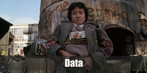 Data's costume is a white collared undershirt, a grey sweater, light washed denim jeans, a patched army green coat, a big-buckled belt, and his multitude of inventions. Start inventing cool gadgets like Data from the Goonies.