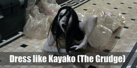 Kayako from the Grudge movies does not have extra arms, eyes, or legs. She doesn't have scaly skin or pointed teeth.