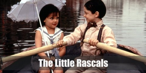 Darla wears a modest white top with sailor-inspired collar and a grey skirt. She carries an umbrella. Alfalfa wears a brown button-down shirt with suspensers and brown pants.