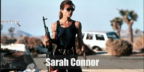 Sarah Connor's costume is a black tank top, black cargo pants, black combat boots, black harness with tactical belt, black cap, and dark sunglasses.