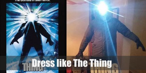 The Thing Costume is a T-shirt, a dark winter puffer coat with hood, dark cargo pants, a winter mask, winter gloves, and winter boots.