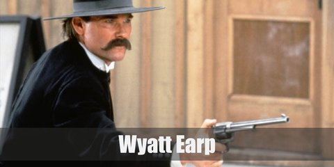 Wyatt Earp's outfit is reminiscent of the respectable wear men don on in the Old West. He wears white dress shirt underneath a black vest, black pants, black coat, and black boots.