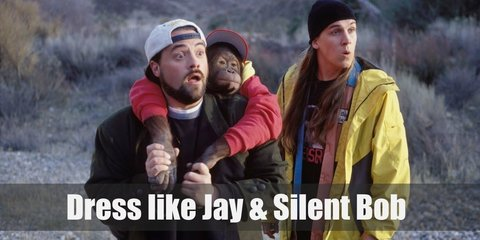Jay costume is bright yellow windbreaker with a black graphic shirt underneath, black jogging pants and a black beanie. Silent Bob costume is a black sweater, olive green trench coat, denim pants, and a white cap.