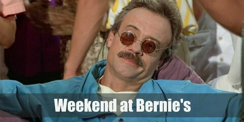 Bernie Lomax costume is composed of a striped shirt under a blue jacket. He also has a pair of light-colored pants and green sneakers. Nail his costume with round sunglasses and fake moustache.