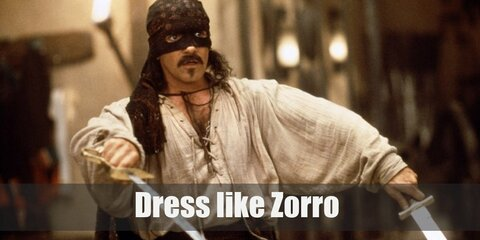 Zorro is most known for his all-black ensemble. He wears a black tunic, black pants, black boots, a billowing black cape, a black Spanish hat, and a black mask.