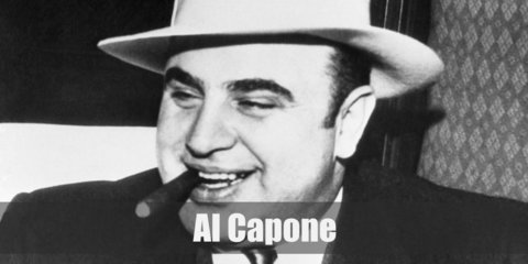 Al Capone costume portrayed in pop culture dressed like him in a white dress shirt, a dark-colored suit, and a white fedora.