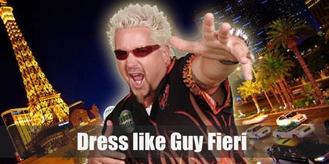 Guy Fieri costume is a flame printed dark button down shirt with matching shades, blonde hair and a goatee, wears chino shorts, rings and metal watch, and studded bracelet.