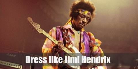 Jimi Hendrix costume is a colorful loose top, dark colored pants with belt. He also dons a equally colorful headband and metallic or gold-toned accessories.