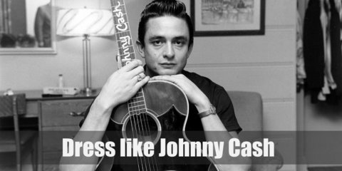 Johnny Cash costume is wearing a black dress shirt underneath a black blazer, black pants, black Oxfords, and a pair of black sunglasses.