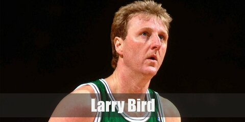 Larry Bird's costume is a green Boston Celtics basketball jersey, green basketball shorts, white knee-high socks with green stripes, and black shoes.