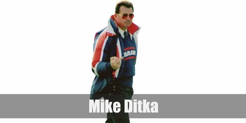 Mike Ditka isa legendary coach who wore his Chicago Bears top over a long-sleeved white shirt and necktie. He wears dark pants and white shoes, too.
