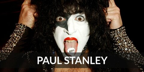Paul Stanley's costume is full of black leather and metal details. He also uses black and white face paint for his iconic look. Paul Stanley is the co-lead vocalist for the hard rock band, KISS.