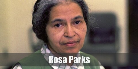 Rosa Parks' costume is her humble worker's blazer and suit, a matching hat, and her arresting number. Rosa Parks is the mother of the freedom movement and is a highly iconic activist.