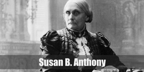 Susan B. Anthony's costume involves a black dress styled with removable collar and cuff. Then finish it with your hair in a bun and with black shoes.