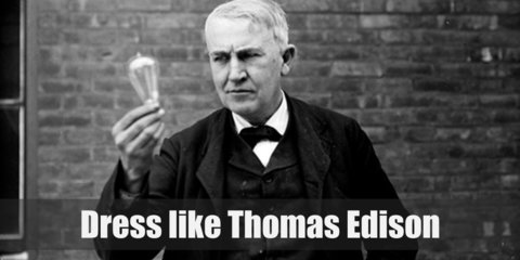 Thomas Edison costume is composed of a black jacket, vest, white shirt, bow tie, and pants. He has white hair and carries a lightbulb.