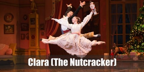 Clara from The Nutcracker costume is a pink night dress with matching pink ballerina flats. She carries a nutcracker toy.