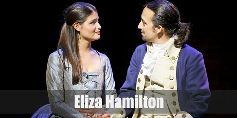 Eliza Hamilton's costume is a modest and simple mint green gown. Eliza Hamilton is just not a wife. She's a philantrophist as well.