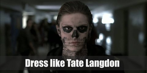 Tate Langdon costume a black shirt, black pants, a black, hooded trench coat, and black boots. His face is also covered in black and white paint.