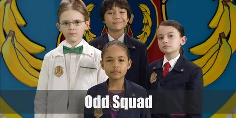 Odd Squad Agents typically wear blazers and pants and scientists have white lab coats. Ms. O, on the other hand, prefers a blazer and a skirt since she's the big boss.