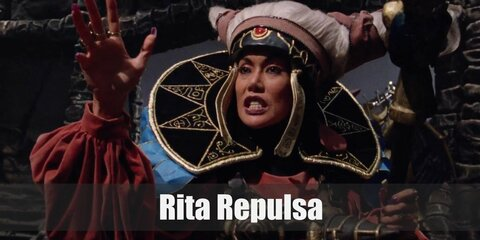 Rita Repulsa's costume is quite unique. It is a mix of looking mystical and nature-based. She wears a long orange dress and has her magical staff with her at all times.
