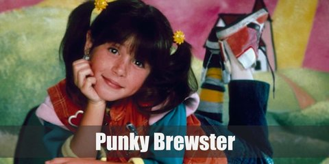 Punky Brewster wears multiple layers of clothing including a color-blocked top and orange vest. She also has striped socks and a fun hi cut sneakers.