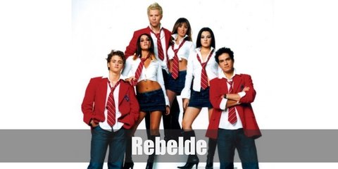 The Rebelde rag tag group of musicians are most known for their rendition of their school uniform. They are wearing denim bottoms paired with a white collared top, a red necktie, and a red blazer.