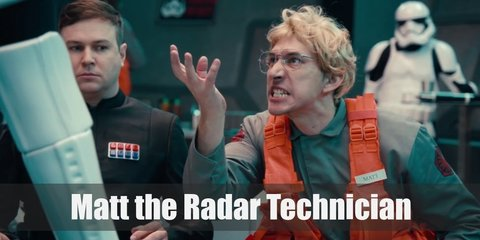 Matt the Radar Technician's costume is grey coveralls with a First Order patch, and orange utility vest, aviator glasses, and a messy, blond wig.