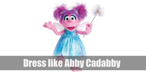 Abby Cadabby costume purple hair tied in pigtails and wearing a sky blue dress and pink fairy wings. She also goes everywhere with her cute purple and blue magic wand.