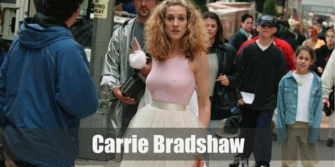 Carrie Bradshaw's iconic costume consists of a pink tank top with tulle skirt. She also wore a pair of pumps to complete her outfit!