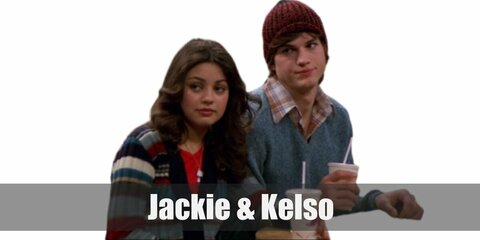 Jackie's costume is a patterned top, colorful pants and vest, an ascot, and a wavy brunette wig. Kelso's costume is a patterned, button-down top, denim jeans, and a shaggy blond wig.