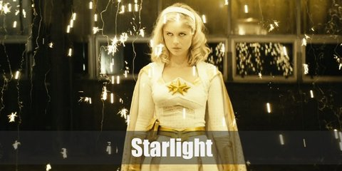 Starlight's outfit is reflected from her name and her bright blonde wig. She wears a white long-sleeve midi dress with gold details, gold gloves, and gold boots.