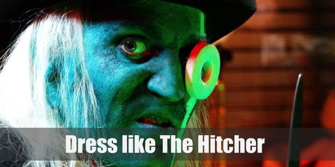 The Hitcher looks weird and creepy. He has green skin and a giant white Polo candy on one eye. He has white hair and wears all black with a top hat.