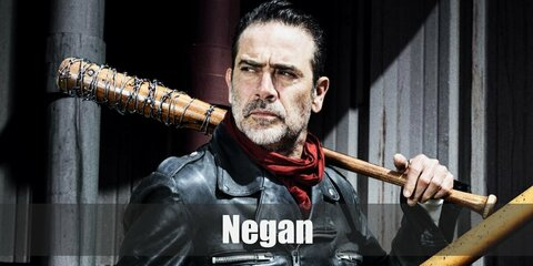 Negan's costume is a red scarf, a black leather jacket, brown pants, black gloves, a salt and pepper fake moustache, and a bat with barbed wire.