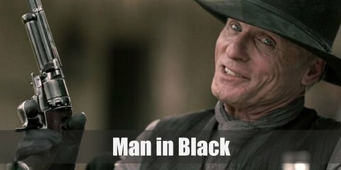 The Man in Black's costume is a grey undershirt, a black three-piece suit, black boots, black gloves, a grey scarf, and a black cowboy hat. The Man in Black is a Westworld veteran looking for a secret.